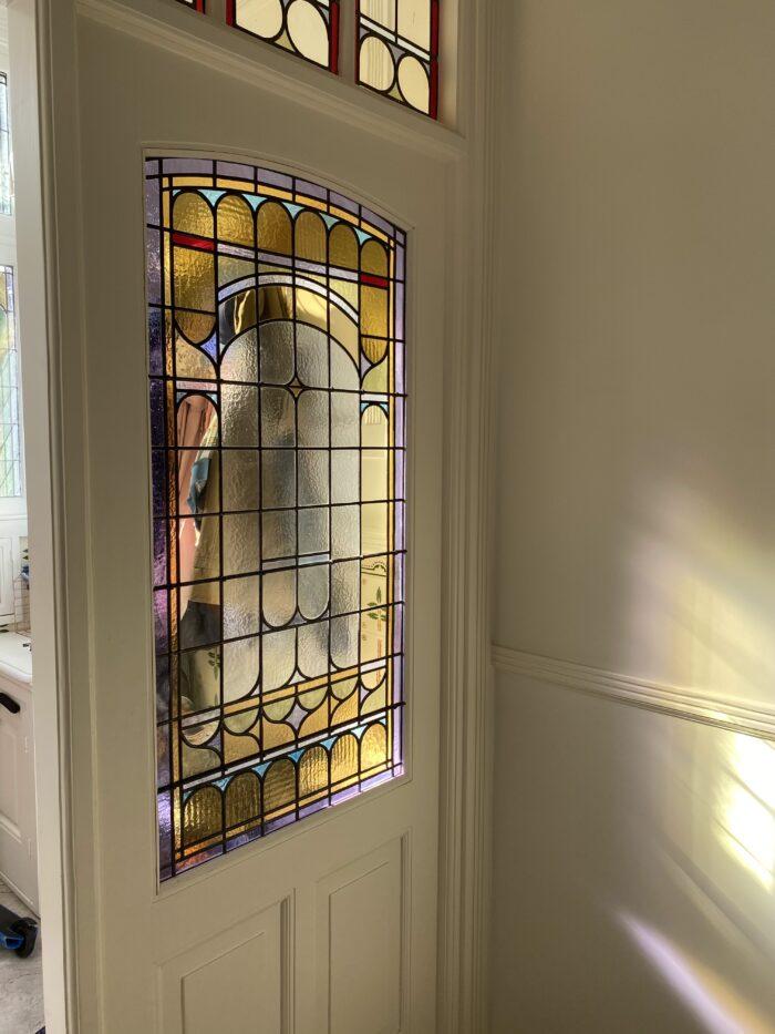 Art Nouveau glas in lood tochtportaal Statenkwartier-min